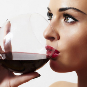 a girl drinking wine